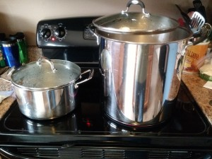 Hot liquor being brought to a boil on the left, jar sanitize water on the right.