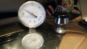 Pressure canner is coming to pressure.  The weight is the black thing on the right.