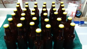 Boring pic of yellow capped bottles of lager